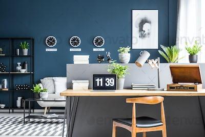 Dark blue interior with workspace