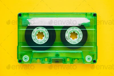 Audio cassette tape on yellow background