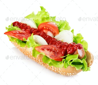 Hot dog with sausage and fresh tomato isolated on white.