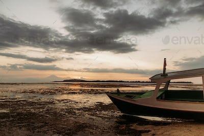 pleasure boat on low tide coastline