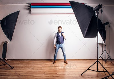 Portrait of a young hipster man in a studio.