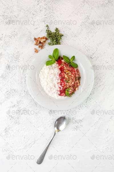 Plate with cottage cheese, served strawberry sauce, walnuts and