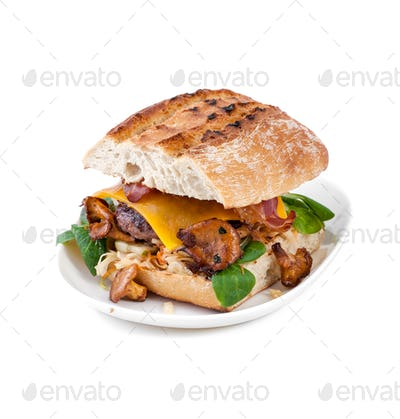 Burger handmade with beef chop and mushrooms chanterelles on an