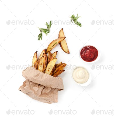 Slices of baked potatoes, ketchup, creamy sauce and grilled onio