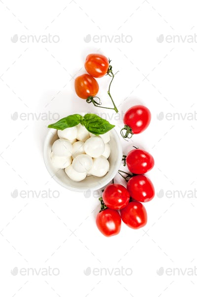 Fresh Cherry Tomatoes (mini) and Mozzarella cheese on a clean wh