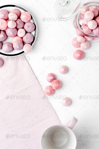 Multicolored meringues in purple and gently pink colors on a whi