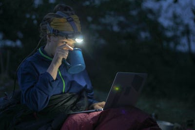 camping laptop at night