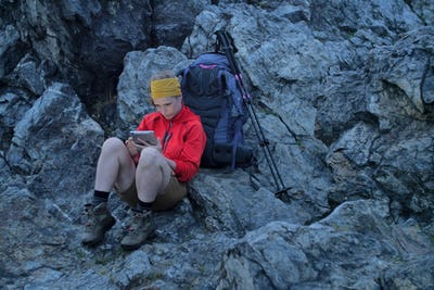 hiker using portable tablet technology