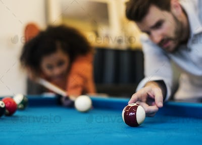 Happy friends playig pool together