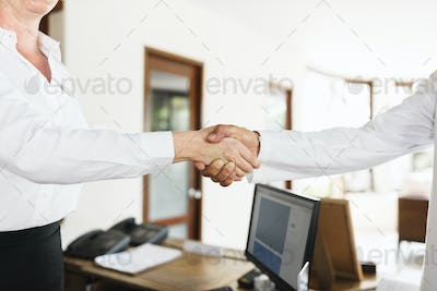 Receptionist is greeting hotel guest