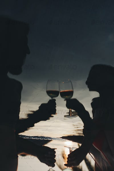 Couple drinking wine in a pool