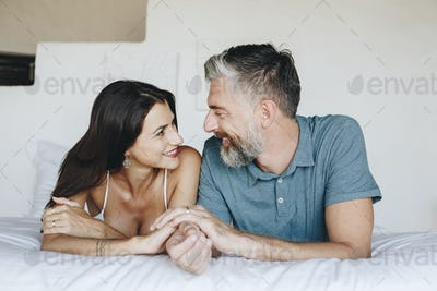 Couple spending their honeymoon in bed