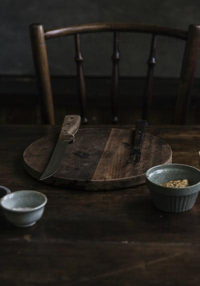 Wooden cutting board in a dark room