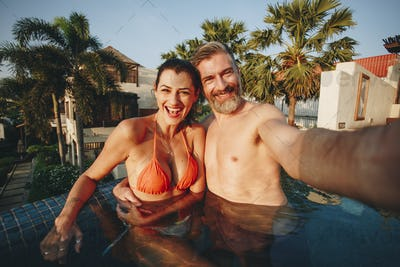 Couple taking a selfie in a pool
