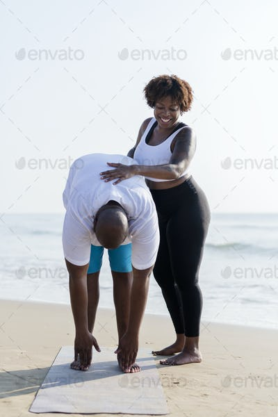 African American couple working out at the beach