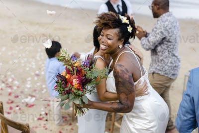 African American xouple getting married at the beach