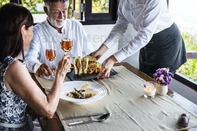 Mature couple having lunch at a restaurant