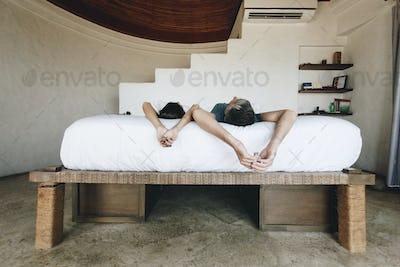 Honeymoon couple relaxing in a hotel room