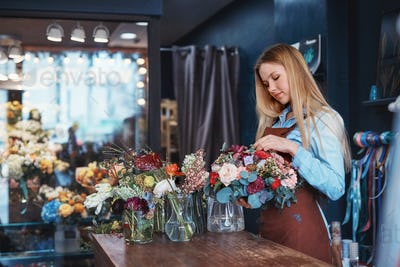 Attractive florist at the counter