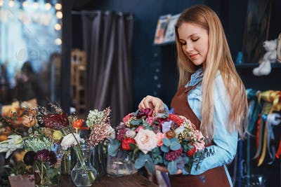 Young florist at the counter