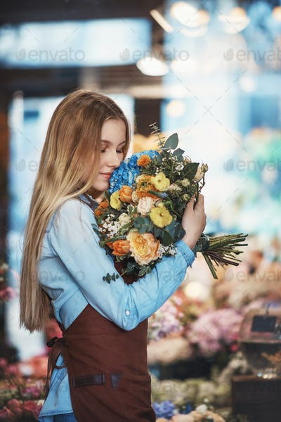 Attractive florist with a bouquet of flowers