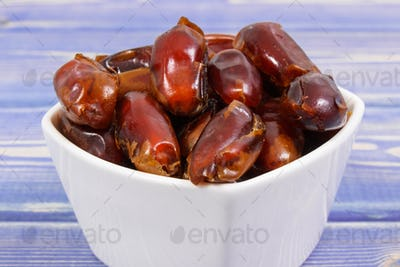 Heap of dates as source natural vitamins, minerals and dietary fiber, healthy nutrition