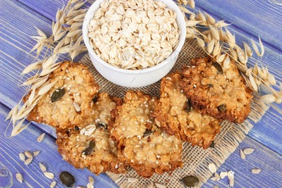 Fresh baked oatmeal cookies, flakes and ears of oat, healthy dessert concept