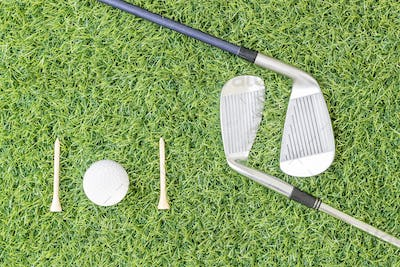 Golf club and golf ball on green grass-7