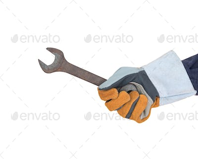 Hand in glove holding spanner on white