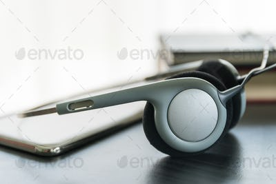 Headphones with book and mobile phone_-2