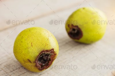Pear is going to rot on wooden