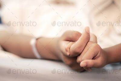 hands of patients and visiting