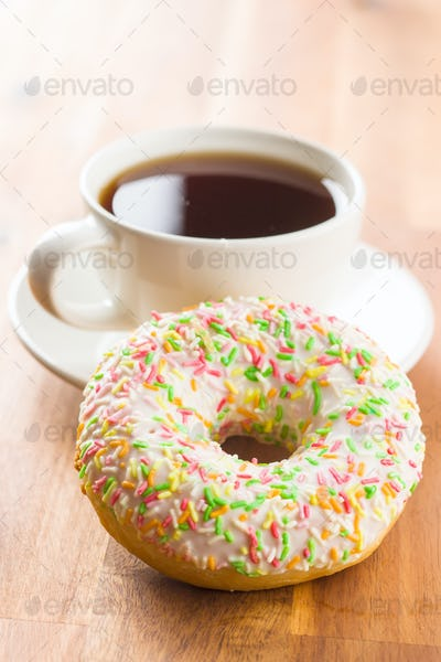 Sweet donut and cup of tea.