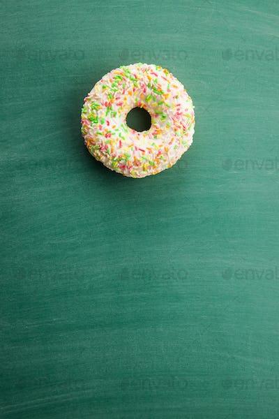 Sweet sprinkled donut.
