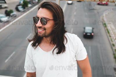 Beautiful man portrait wearing stylish sunglasses