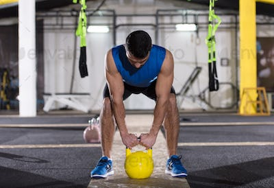 man exercise with fitness kettlebell