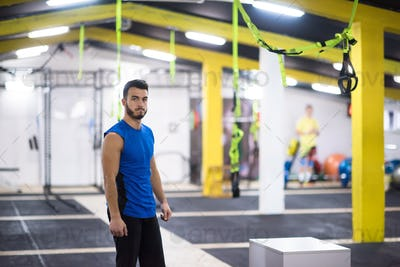 portrait of young man at cross fitness gym