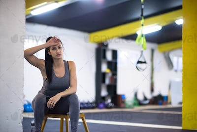 young athlete woman sitting and relaxing