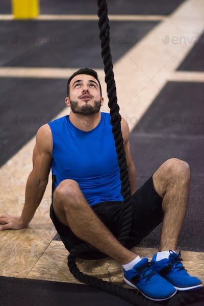 man relaxing before rope climbing