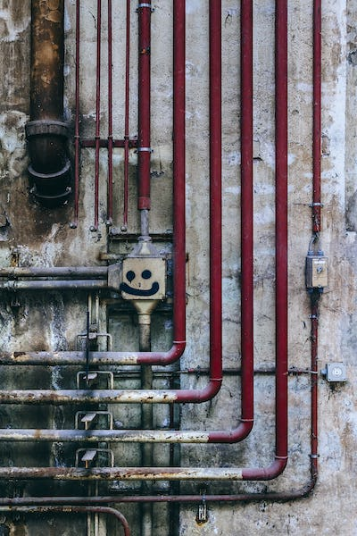 Old industrial wall of pipes and obsolete parts