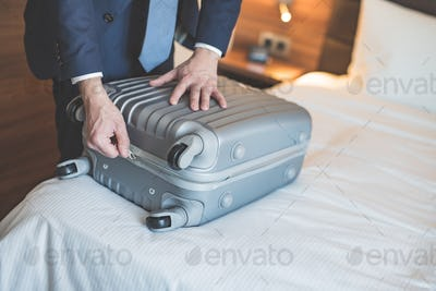 Young businessman with a suitcase