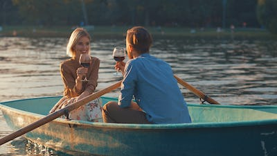 Attractive couple with glasses in a boat