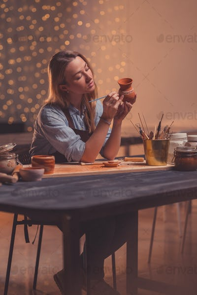 Young woman in a pottery studio