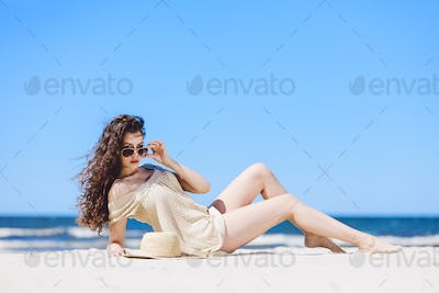 A young pretty woman laying on the beach