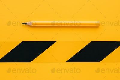 Classic yellow carpenter handyman pencil on same color backgroun