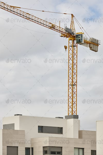Modern building and crane machinery structure. Construction industry. Vertical