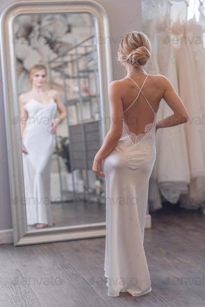 Attractive bride at the mirror