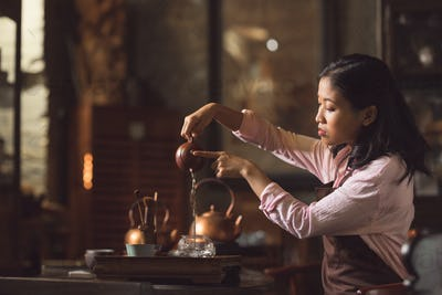 Young girl pouring tea
