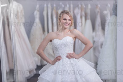 Smiling young bride in white dress