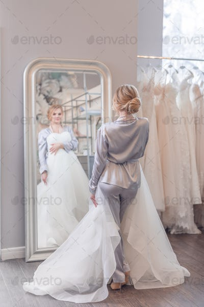 Attractive young woman at the mirror